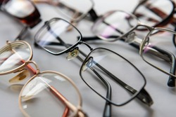 A display of prescription eye glasses in different styles and designs isolated with a white background.