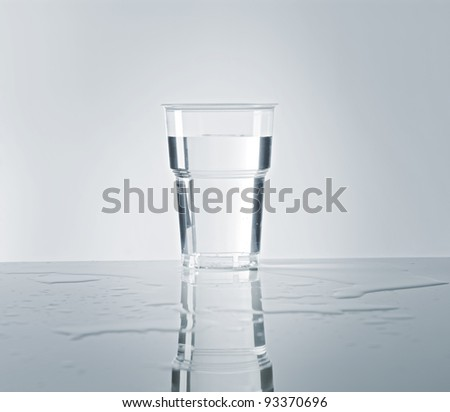 A Disposable plastic cup filled with water.