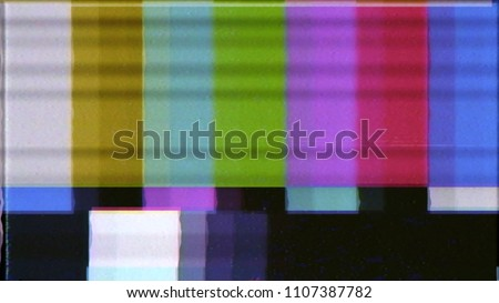 A distorted tv transmission or VHS tape, a noisy signal of SMPTE color bars (a television screen test pattern).