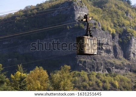 A disused cable car hangs over the river in Chiatura, Georgia - A Mining Town that has had a lot of interest with tourists in the last 2 years.