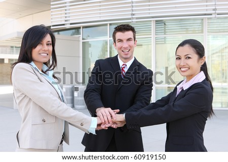 A diverse attractive man and woman business team at office building celebrating