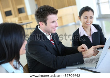 A diverse attractive man and woman business team in meeting