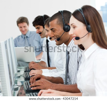 A diverse business group with headset on working in a call center