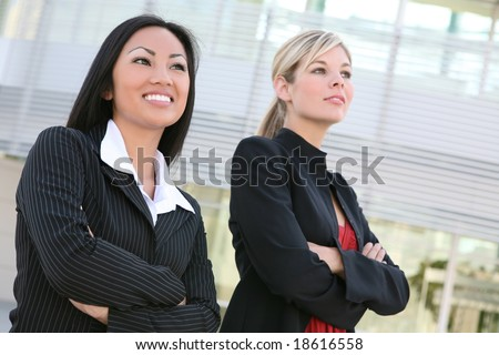 A diverse business woman team outside office building
