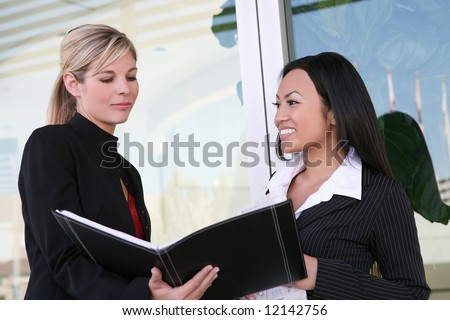 A diverse business woman team working on a project