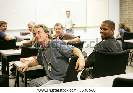 A diverse group of adult education students in class.