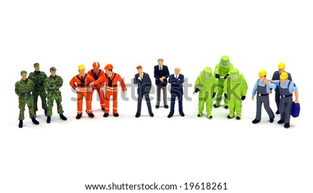 A diverse group of workers standing in a row against a white background. Diversity or teamwork concept.