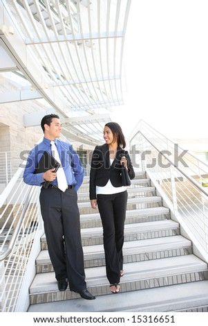 A diverse man and woman business team at their company office building - stock photo