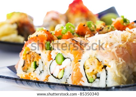 A diverse selection of delicious Japanese sushi rolls.