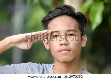 A Diverse  Teen Male Saluting