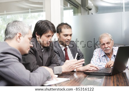 A diversed group of young business executives having a meeting with a senior businessman #85316122