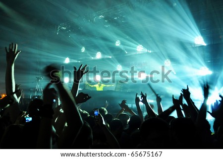 A dj performing at a disco rave - stock photo