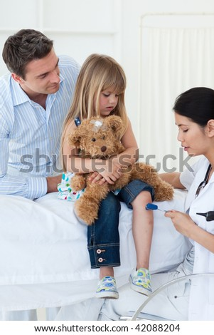 A doctor examining a patient against a white background