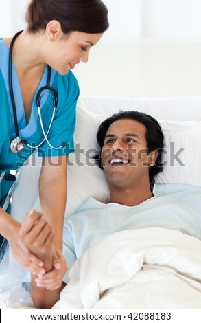 A doctor examining a patient lying on a hospital bed. Medical concept.