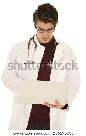 a doctor looking down at his laptop with his stethoscope around his neck.