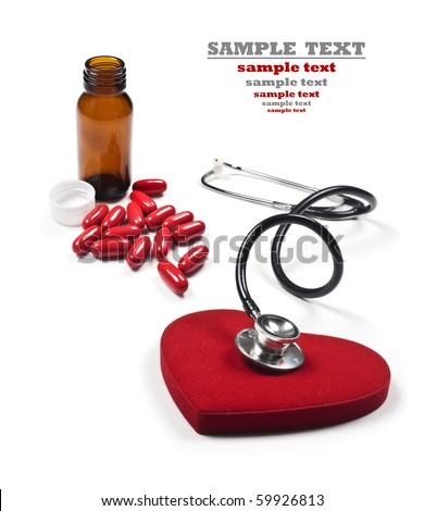 a Doctor's stethoscope listening to a healthy red heart and pill bottle with pills
