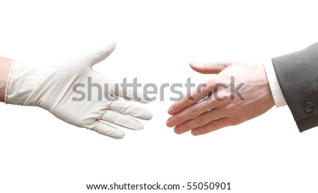 A doctor shaking hands with a business man