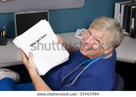 A doctor smiles as he displays a rather large document he must read and understand.  Perfect for any health care reform inference.  Copy space is provided on the paper.