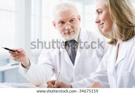 A doctor teaches a student