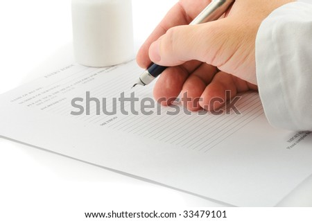a doctors hand with an ink pen
