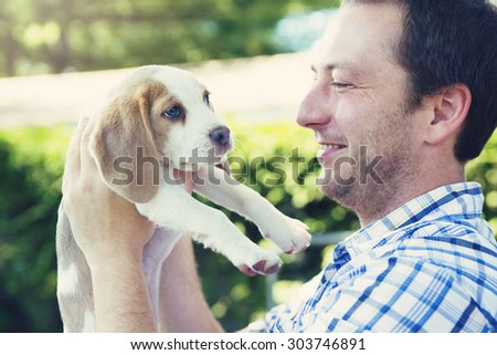 A dog and his owner outside