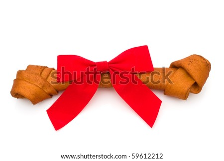 A dog bone with a bow isolated on a white background, Dog treat