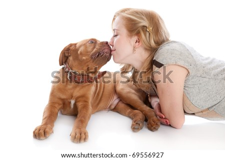 a dog is licking her beautiful mistress. isolated on a white background