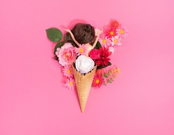 a doll in a cornet with flowers, a concept for Valentine's Day or Mother's Day