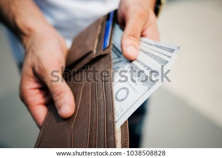 A doller bills in a wallet #1038508828