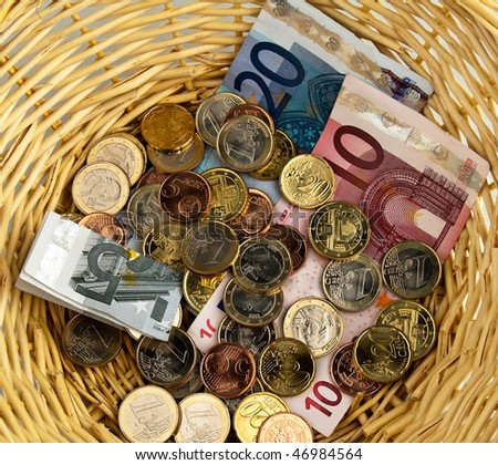 A donation basket for collection. Donation of euro