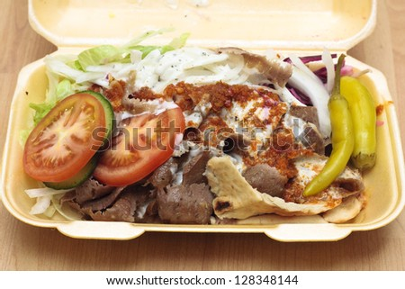 A doner kebab in styrofoam container