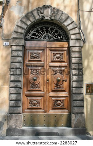 A door of an elegant palace in Lucca, Tuscany,Italy