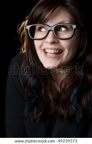 A dorky girl with goofy glasses on black background.