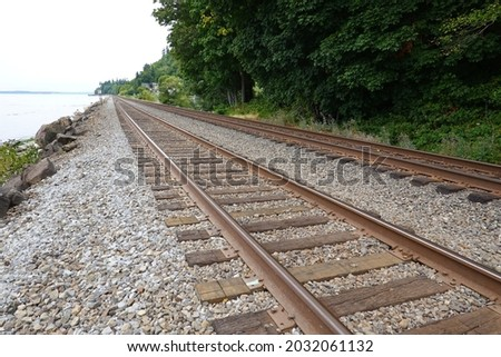 A double-track railway usually involves running one track in each direction, compared to a single-track railway where trains in both directions share the same track.