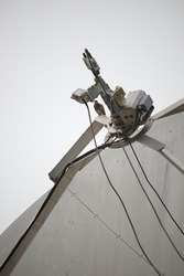 A dove preached  on the dish antenna .