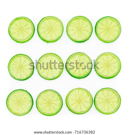 A dozen of lime slices isolated on a white background #716736382