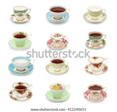 A dozen vintage tea cups on a white background #412240651