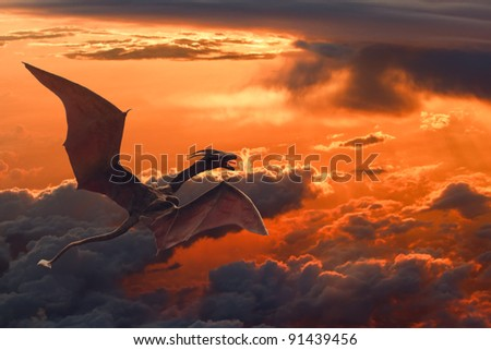 Stock Photo a dragon flying over orange sunset clouds