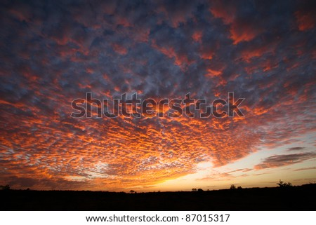 A dramatic cloud formation with amazing colors right across the sky