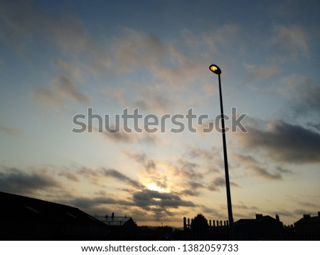 A dramatic dawn with dramatic sky #1382059733