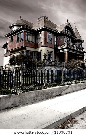 A dramatic image of a Victorian house, processed to give it a foreboding appearance
