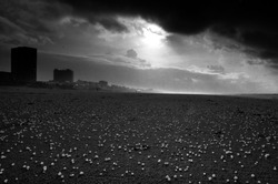 A dramatic scene on Zandvoort beach with passing storm and hale on the ground