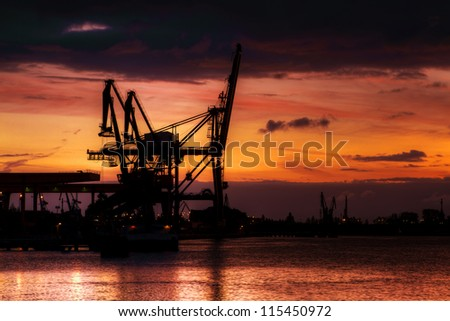 A dramatic sunrise over container terminal