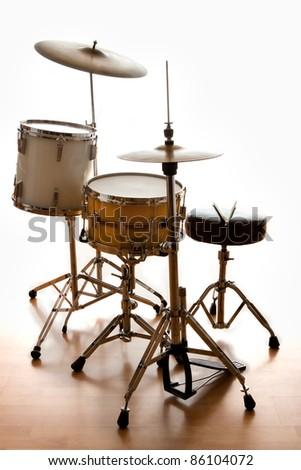 A dramatically back lit drum set ready for a gig