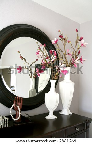 A dresser with flowers inside a home interior