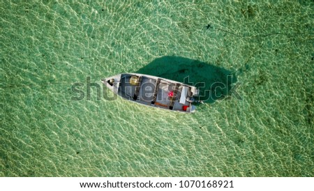 A drone aerial photo of a lonely boat awaiting for high tide #1070168921