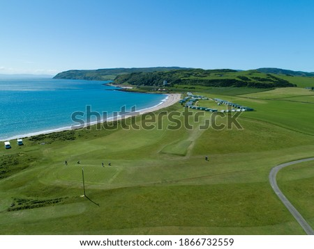Photo of  a drone aerial shot of Dunaverty Beach and caravan park