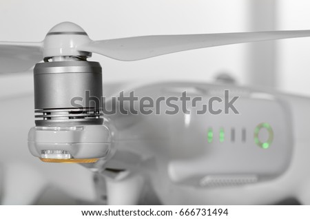 A drone battery and a propeller, focus is on the propeller