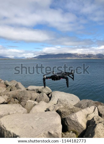 A drone flies near Reykjavik in Iceland #1144182773