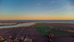 A drone view of the River Alde at Orford Ness in Suffolk, UK at sunset